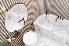 4_-elegancki-apartament-w-samym-centrum-Warszawystyl-wnętrza-art-deco-sztukaterie-i-złoto-luksusowe-dodatki