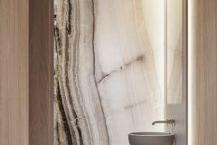 09-2-japandi-toaleta-w-kolorach-ziemi-i-stylu-japandi-drewno-naturalny-kamień-w-łązience-proejktu-OSOM-group-Warszawa-Hamptons-bathroom-interior-design-OSOM-group