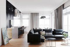 2-minimalistyczny-styl-wnetrza-z-duża-część-dzienną-_-dominuje-czarny-i-grafitowy-oraz-jasne-drewno-mieszkanie-w-Warszawie